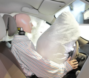 Defective Seatbelt Design/Improper Airbag Deployment